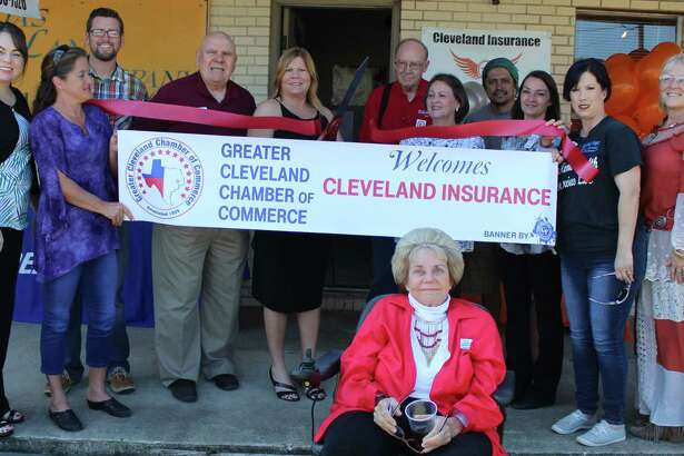 The Greater Cleveland Chamber of Commerce welcomes Cleveland Insurance with a ribbon cutting ceremony on Oct. 11. Insurance Agent Kelly Barton cuts the ribbon to welcome her business.