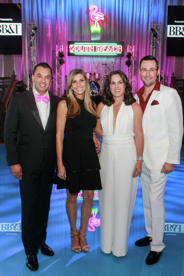 """Co-chairs Dr. Devinder and Gina Bhatia, from left, and Molly and Matthew LaFauci at the Children's Museum of Houston's """"Miami Vice"""" gala.   (For the Chronicle/Gary Fountain, October 14, 2017)"""