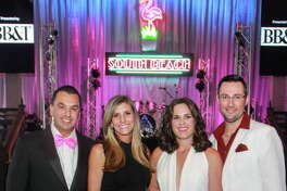 "Co-chairs Dr. Devinder and Gina Bhatia, from left, and Molly and Matthew LaFauci at the Children's Museum of Houston's ""Miami Vice"" gala.   (For the Chronicle/Gary Fountain, October 14, 2017)"