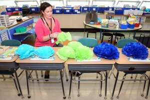 Lynn Martin prepares paper flowers to decorate her second-grade classroom at Chapel Street Elementary School in Stratford, Conn. Aug. 25, 2017. Schools open in Stratford on Thursday.