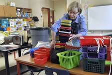 Michele Masi, a kindergarten teacher at Ellsworth Avenue School in Danbury, organizes her classroom Monday, June 26, 2017, for the start of school in the fall and to  accomadate a summer school program that will soon be using her classroom. Masi intends to take the rest of the summer off.