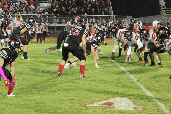 The Kirbyville Wildcats (right) prepare to play offense against the Coldspring-Oakhurst Trojans on Oct. 13.
