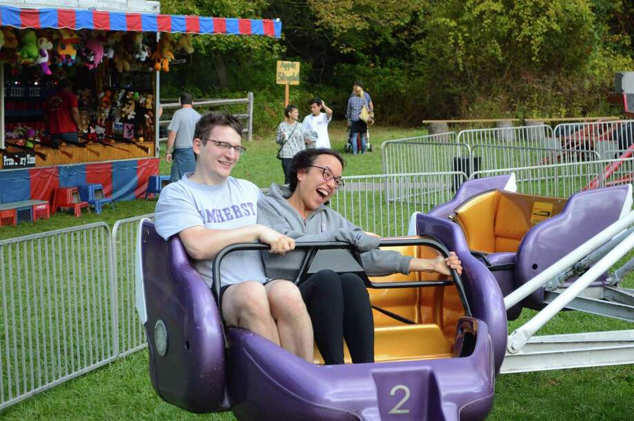 Arthur Roski and Clarice Carmichael, both of New Canaan, take a spin on the Sizzler at the Fall Fair at New Canaan Nature Center, Saturday, Oct. 14, 2017, in New Canaan, Conn. Photo: Jarret Liotta / For Hearst Connecticut Media / New Canaan News Freelance