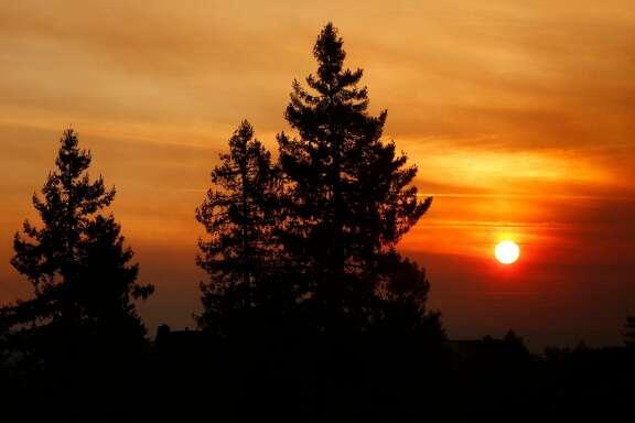 The rising sun peers through the smoke on Sunday, Oct. 15, 2017 over Santa Rosa, Calif. (Genaro Molina/Los Angeles Times/TNS)