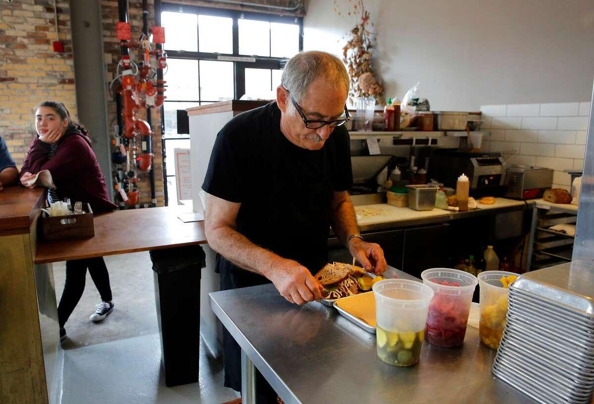 Jeff Mason makes sandwiches.