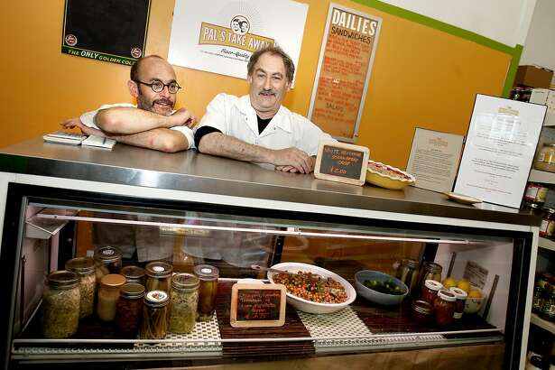 David Knopp (left) and owner Jeff Mason share a light moment behind the counter during a busy lunchtime. Pal's Take Away is located inside Tony's Market at the end of 24th Street near Potrero.