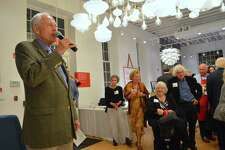 President Bob Mitchell introduces honoree photographer Larry Silver, at right with his wife, Gloria, at the Westport Historical Society's first-ever gala event held at Design Within Reach, Friday, Oct. 13, 2017, in Westport, Conn.