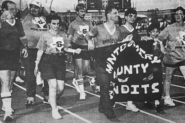 Local Special Olympics athletes march in the parade of athletes during opening ceremonies of a meet. The team from Conroe was among the more than 3,600 who participated in the Texas Special Olympics 23rd Annual Summer Games in July 1990.