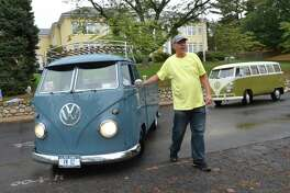 Event organizer David Abelow guides a pair of vintage Volkswagen Type 2 buses onto Veteran's Green during the  3rd Annual Aircooled Car Show organized by the Small Car Company.org to benefit Homes with Hope charity, on Sunday October 15, 2017 in Westport Conn.