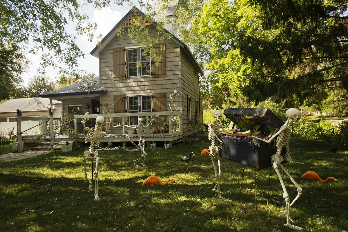 An elaborate Halloween-themed display covers the front lawn of Rich and Karen Marshall's home on Ashman Street. Skeletons can be seen fleeing from the house with a large treasure chest in tow. Rich is responsible for the decorations on the outside of their home, while Karen has decorated the interior for the Halloween season. (Katy Kildee/kkildee@mdn.net)