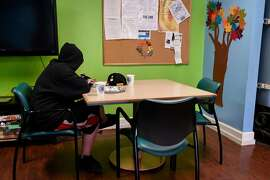 A homeless youth eats lunch at the Bill Wilson Center's Drop-in Center in San Jose, Calif., on Tuesday September 26, 2017.