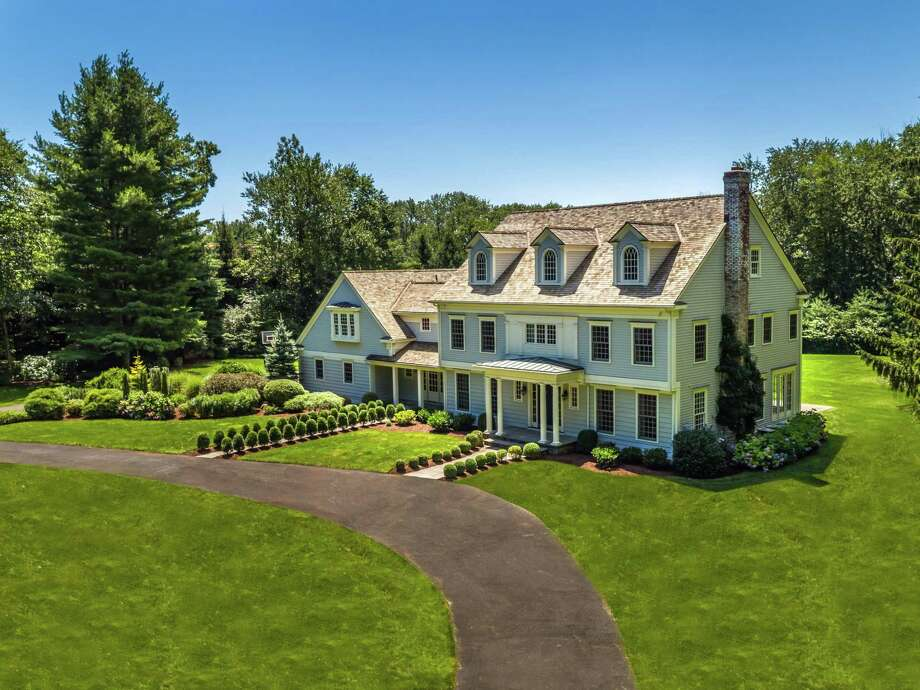 The colonial house at 25 Apple Tree Lane sits on a level property of 3.25 acres.