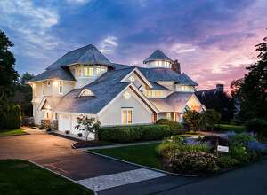 The 9,282-square-foot colonial contemporary house at 10 Minute Man Hill sits high above the Compo Beach neighborhood with views of nearby Long Island Sound.