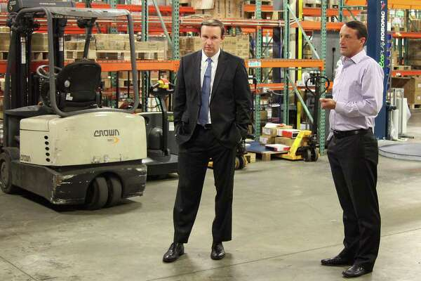 U.S. Sen. Chris Murphy and Patrick Wind, president of the Wind Group, talk to Wind Hardware employees about fair trade practices on Friday, Oct. 13, 2017, in Newtown, Conn.