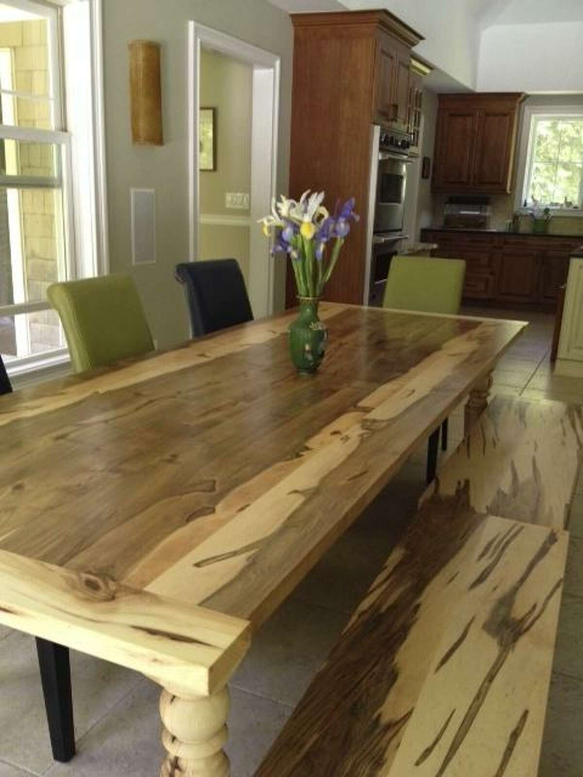 A farm-style table made by City Bench for a Woodbridge family from a tree that fell on their property.