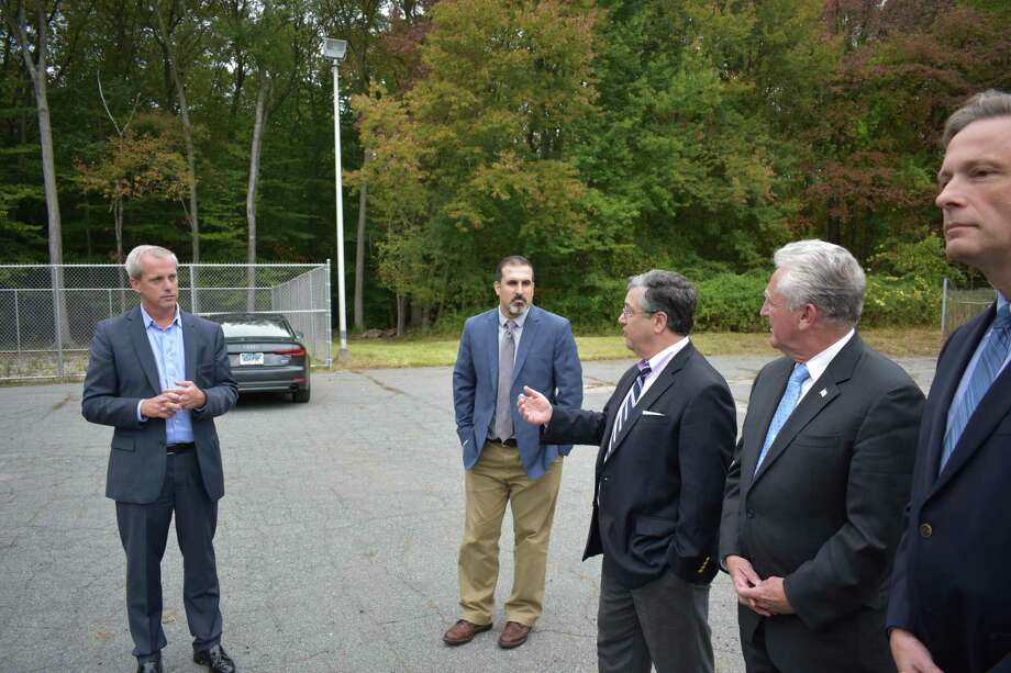 John Emra, president of AT&T Connecticut (left), listens on Monday, Oct. 16, 2017, as New Canaan First Selectman Robert Mallozzi speaks during the unveiling of a new cell phone tower at 290 New Canaan Ave. in Norwalk, Conn. Also on hand are AT&T engineer Robert Klein, center;  Norwalk Mayor Harry Rilling, second from right; and state Rep. Fred Wilms (R-142), right. Photo: Alexander Soule / Hearst Connecticut Media / Stamford Advocate