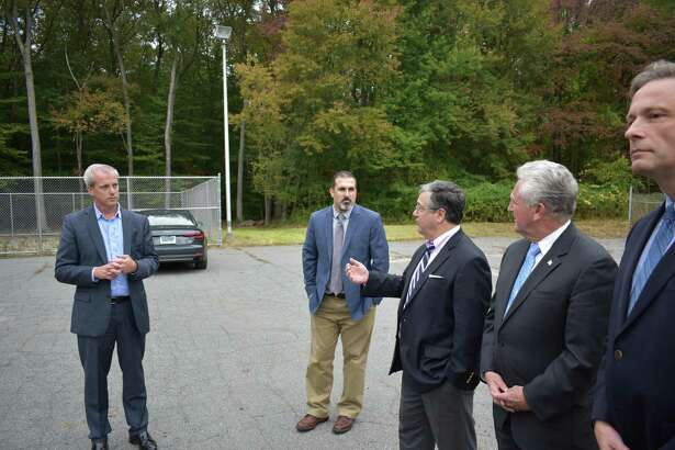 John Emra, president of AT&T Connecticut (left), listens on Monday, Oct. 16, 2017, as New Canaan First Selectman Robert Mallozzi speaks during the unveiling of a new cell phone tower at 290 New Canaan Ave. in Norwalk, Conn. Also on hand are AT&T engineer Robert Klein, center;  Norwalk Mayor Harry Rilling, second from right; and state Rep. Fred Wilms (R-142), right.