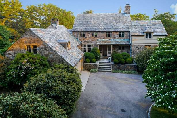 The stone and wood colonial at 42 Old Farm Road was not designed by famed architect Frazier Foreman Peters but he was the stone mason on this construction project in 1931.