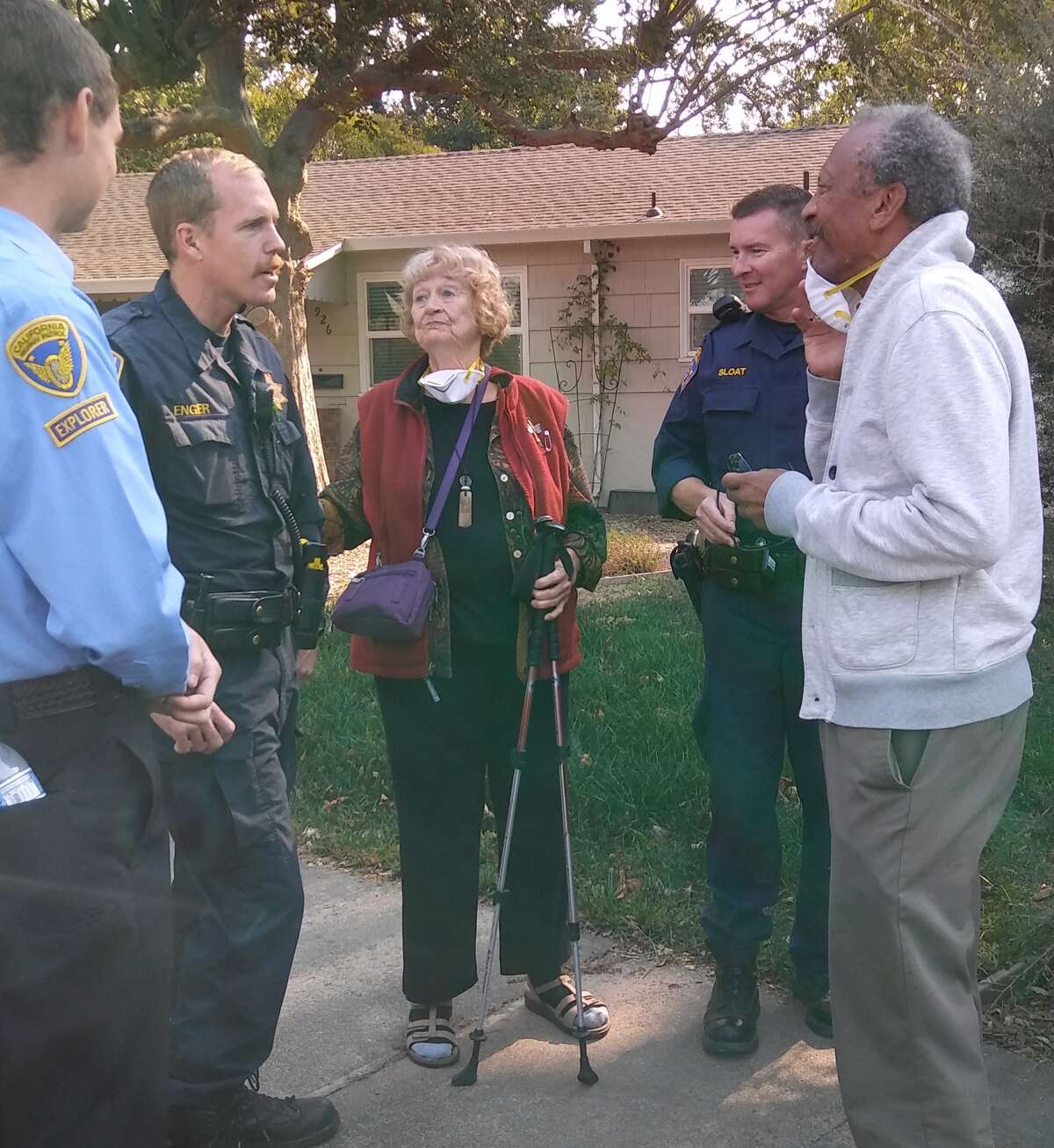 Sara and her husband greet officers after they bring her Subaru to safety.