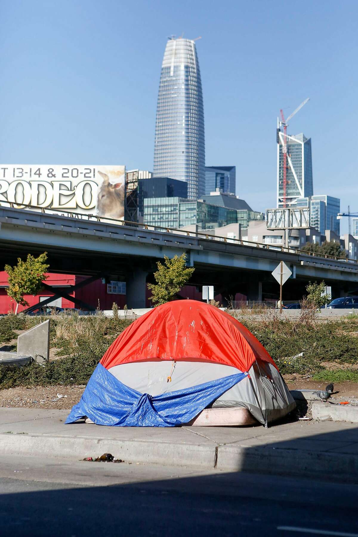 One tent from a tent encampment on Fifth Street is seen with the Salesforce tower on October 15, 2017 in San Francisco, Calif.