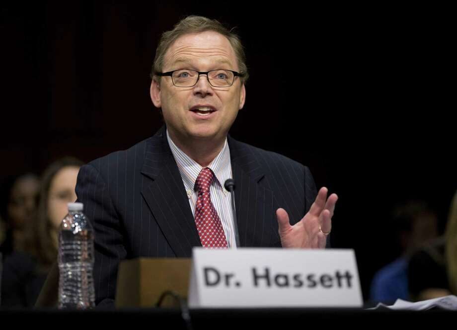 Kevin Hassett, chairman of President Trump's Council of Economic Advisers, predicts that cutting corporate taxes will result in more investment and higher worker wages. The evidence this will occur, however, is disputed. Photo: Evan Vucci /Associated Press / Copyright 2017 The Associated Press. All rights reserved.