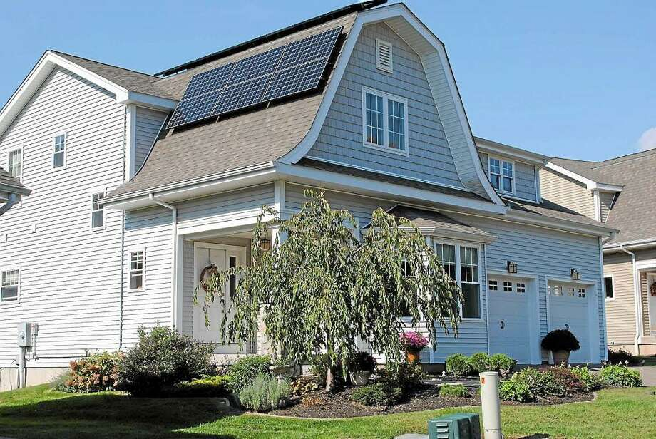The solar panels on this Bartlett Hollow Road house in Middletown generate a third of the home's electrical demand. The homeowners also use geothermal heating. Photo: Hearst Media File Photo