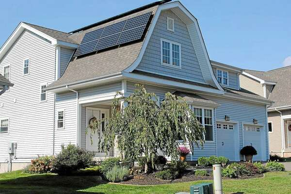 The solar panels on this Bartlett Hollow Road house in Middletown generate a third of the home's electrical demand. The homeowners also use geothermal heating.