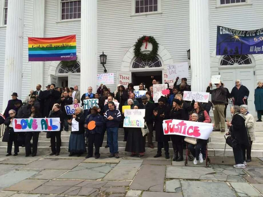 A previous rally on the steps of the First Congregational Church on the Green in Norwalk. Photo: Contributed Photo /