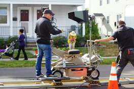 A production company films in September 2014 a ConnectiCare commercial, in Fairfield, Conn. ConnectiCare was one of two insurance carriers to increase its total Connecticut enrollment in 2016, along with Harvard Pilgrim Health Care.