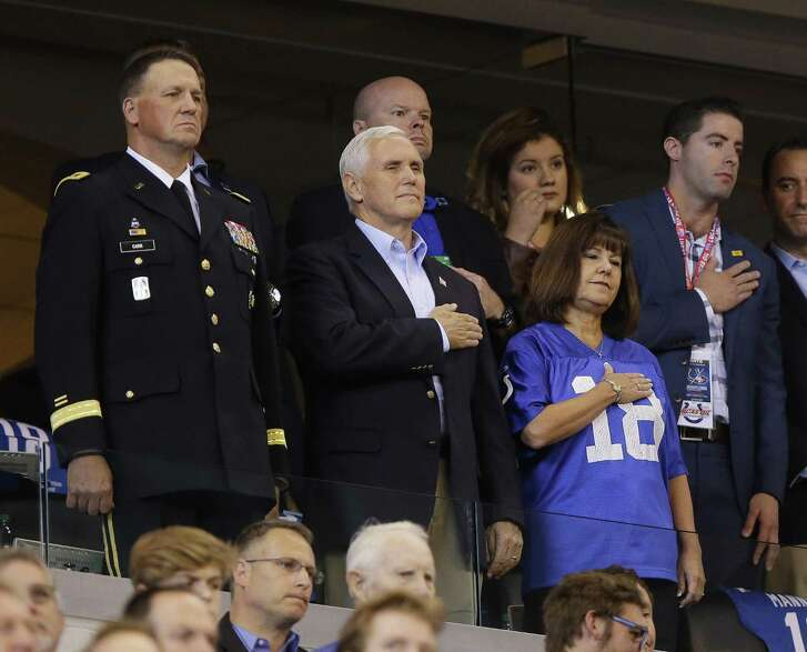 Vice President Mike Pence and wife Kathy stand during the national anthem before the recent game between Indianapolis and the San Francisco. The Pences left shortly thereafter to protest the players who kneeled. A reader says athletes are hurting more than fans.