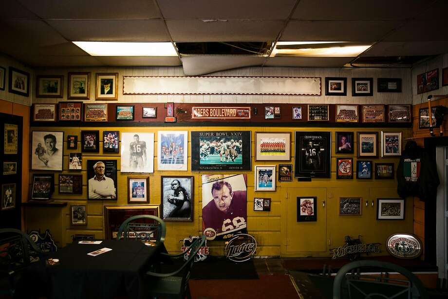 49ers memorabilia and sports collectables line the walls of Piccolo Pete in S.F. Photo: Mason Trinca, Special To The Chronicle
