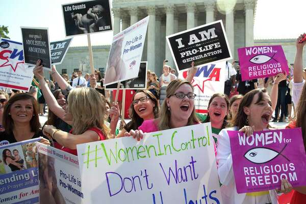 The Trump administration's rule unraveling a mandate for birth control coverage in health plans delights those who view the requirement as an affront to religious freedom, as with this group outside the Supreme Court in 2014.