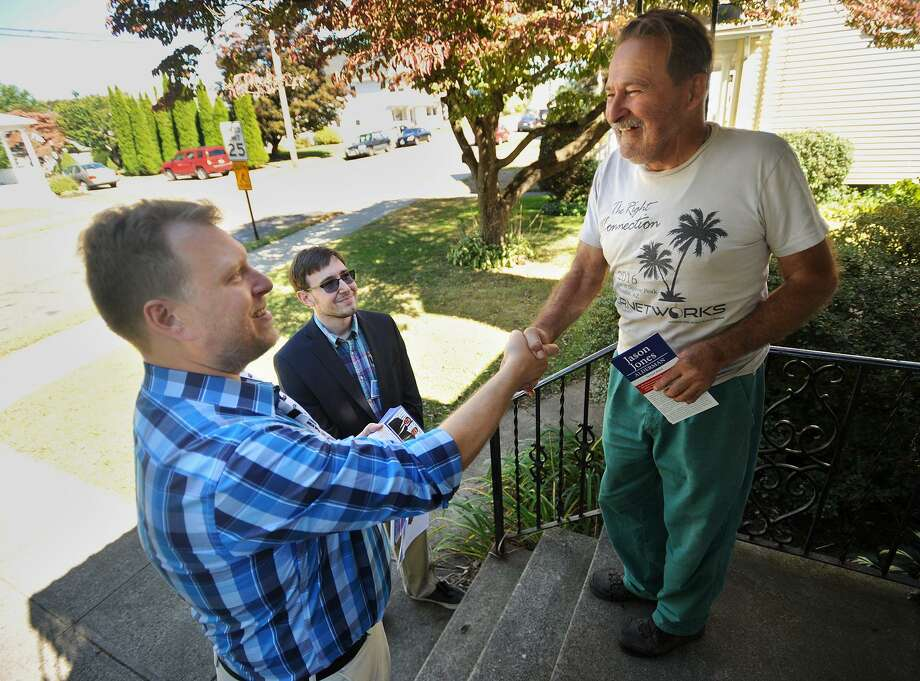 Democratic alderman candidates Kevin Kosty, left, and Jason Jones introduce themselves to voter Georges Gilbert during a day of canvassing for votes in Shelton on Oct. 1. Photo: Brian A. Pounds / Hearst Connecticut Media / Connecticut Post