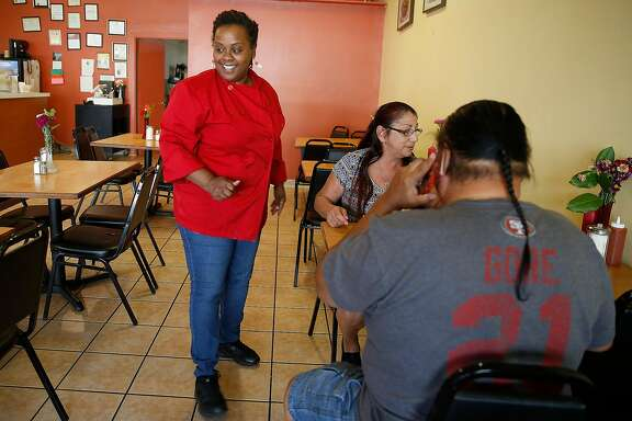 Owner April Spears of Auntie April's Chicken and Waffles talks with customers on Friday, October 6, 2017, in San Francisco, Calif.