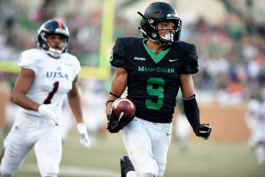 North Texas wide receiver Jalen Guyton (9) runs in for a touchdown against Texas-San Antonio during an NCAA college football game in Denton, Texas, Saturday, Oct. 14, 2017. Photo: Jake King /The Denton Record-Chronicle