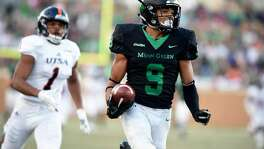 North Texas wide receiver Jalen Guyton (9) runs in for a touchdown against Texas-San Antonio during an NCAA college football game in Denton, Texas, Saturday, Oct. 14, 2017.