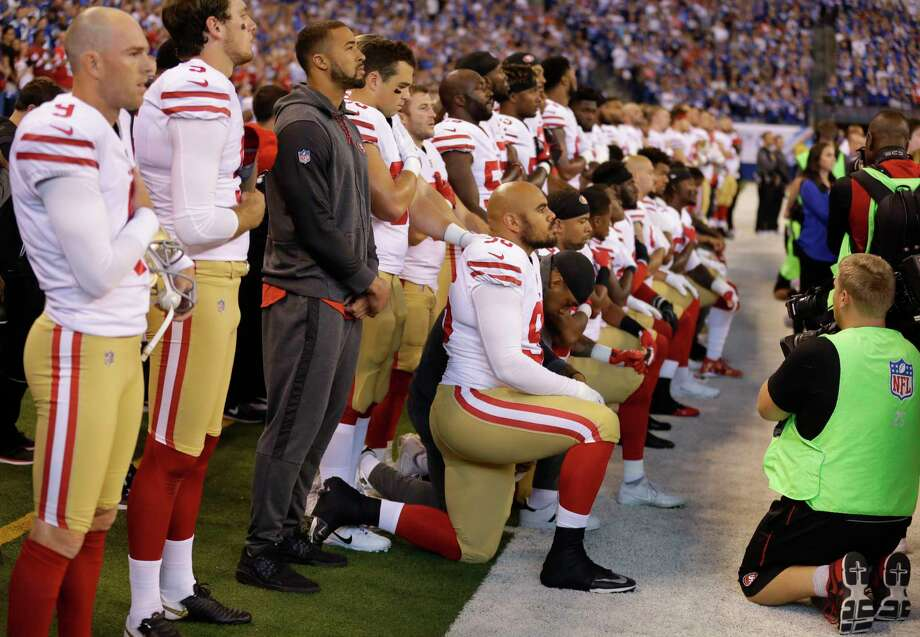 Members of the San Francisco 49ers kneel during the playing of the national anthem before an NFL football game against the Indianapolis Coltson Oct. 8 in Indianapolis. Vice President Mike Pence left the 49ers-Colts game after about a dozen San Francisco players took a knee during the national anthem. (AP Photo/Michael Conroy) Photo: Michael Conroy, STF / Copyright 2017 The Associated Press. All rights reserved.