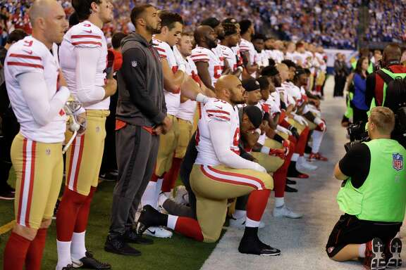 Members of the San Francisco 49ers kneel during the playing of the national anthem before an NFL football game against the Indianapolis Coltson Oct. 8 in Indianapolis. Vice President Mike Pence left the 49ers-Colts game after about a dozen San Francisco players took a knee during the national anthem. (AP Photo/Michael Conroy)