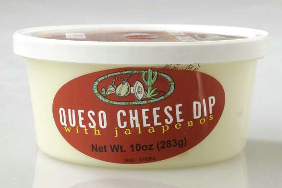 A container of Queso Cheese Dip is shown Wednesday, Oct. 4, 2017, in Houston.  ( Melissa Phillip / Houston Chronicle )