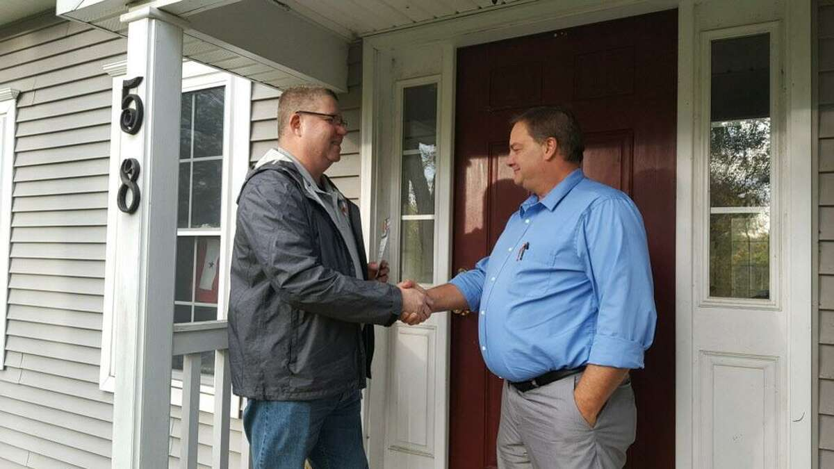 Sean Moriarty, candidate for first selectman in Haddam, greets residents Monday afternoon on the campaign trail.