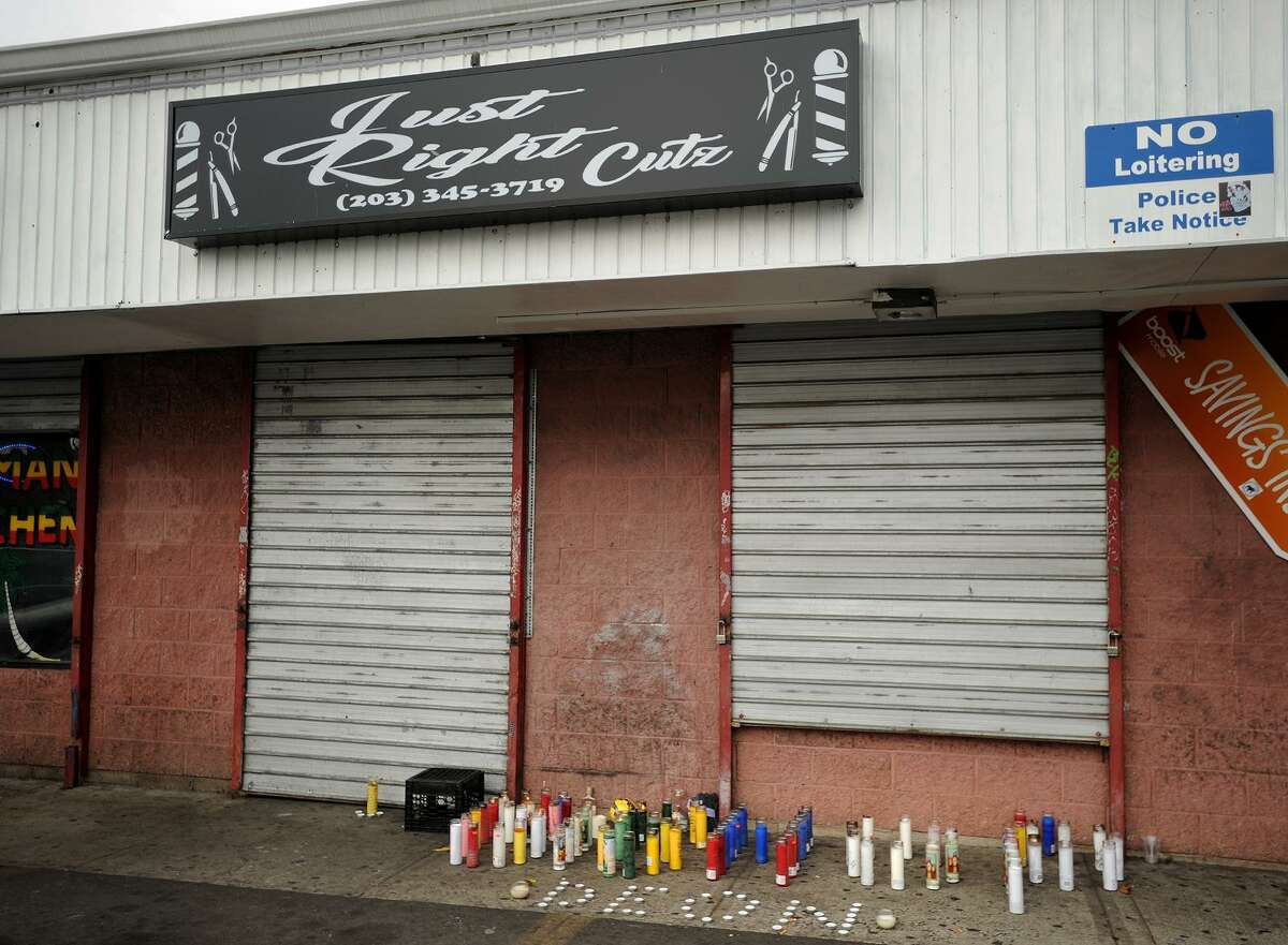 A memorial outside Just Right Cutz barbershop at 500 Park Avenue in Bridgeport, Conn. where Deon Rodney, 31, was shot and killed on Saturday.