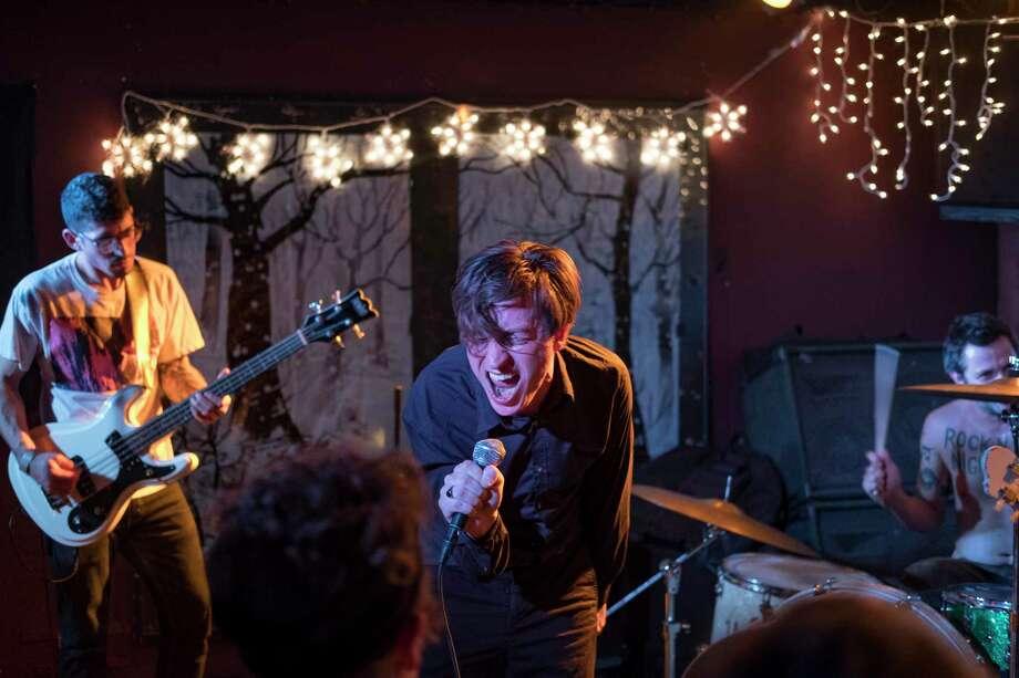 "Houston rock band Poizon is Shawn Adolph (singer), Kyle GIonis (guitar), Halston Luna (bass) and Josh ""Wolf"" (drums) Photo: Mark Lochridge"