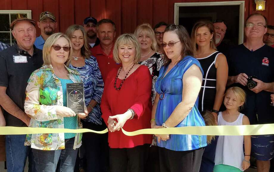Michele Kimmons cuts the ribbon welcoming her business, Michele Kimmons Properties, LLC into the Coldspring/San Jacinto County Chamber of Commerce on Oct. 8. Michele Kimmons Properties, LLC is located at 641 Hwy 156 Point Blank, Texas and offers every benefit to make its customers feel at home when coming in to new areas. Photo: Submitted