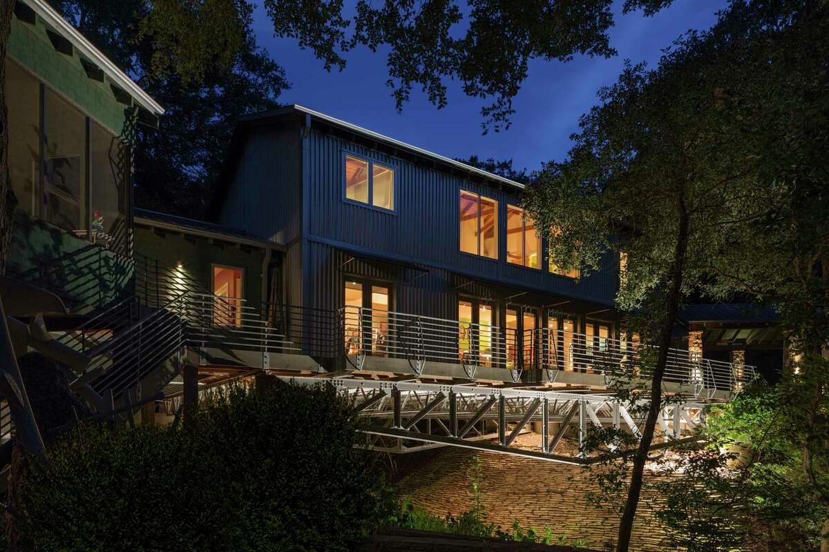 """The home of Rodney and Mary Koenig, dubbed """"the Bridge house,"""" stretches over a ravine in Fayette County. It was designed by Joe and Gail Adams of Adams Architects."""