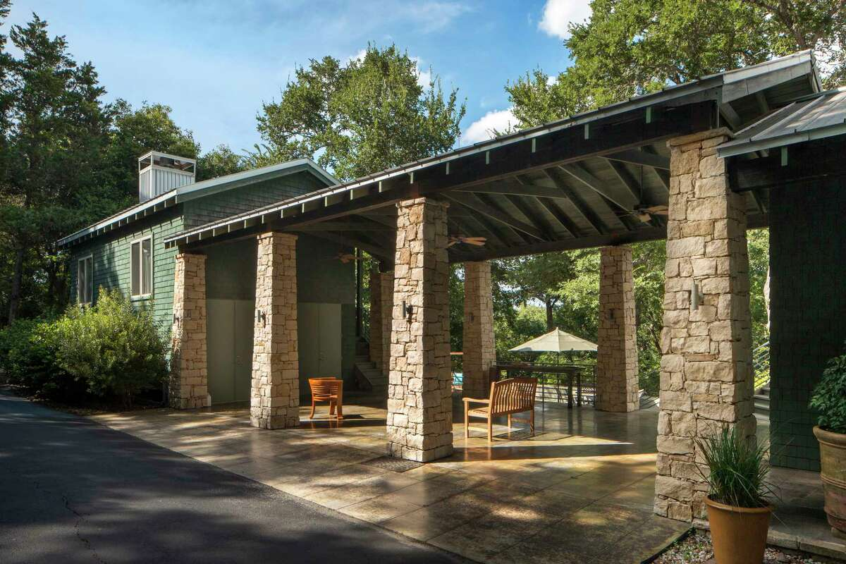 An expansive carport with limestone-clad pillars doubles as entertaining space.