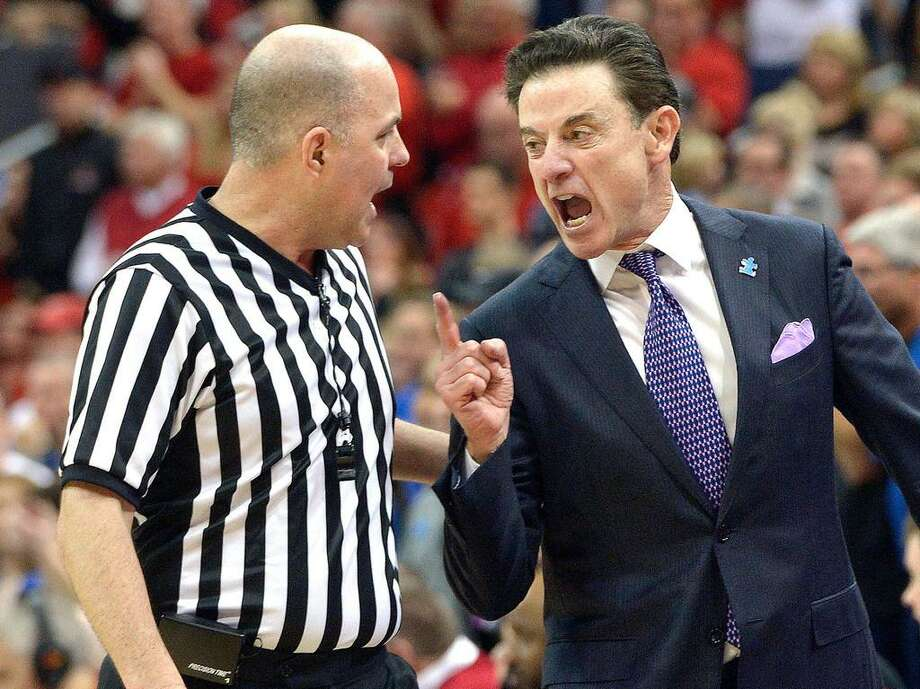 In this Feb. 20, 2016, file photo, Louisville head coach Rick Pitino, right, argues with referee Brian Dorsey during the second half of an NCAA college basketball game against Duke, in Louisville Ky. Louisville's Athletic Association has officially fired coach Rick Pitino, Monday, Oct. 16, 2017, nearly three weeks after the school acknowledged that its men's basketball program is being investigated as part of a federal corruption probe. Photo: Timothy D. Easley /AP Photo