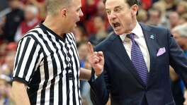 In this Feb. 20, 2016, file photo, Louisville head coach Rick Pitino, right, argues with referee Brian Dorsey during the second half of an NCAA college basketball game against Duke, in Louisville Ky. Louisville's Athletic Association has officially fired coach Rick Pitino, Monday, Oct. 16, 2017, nearly three weeks after the school acknowledged that its men's basketball program is being investigated as part of a federal corruption probe.