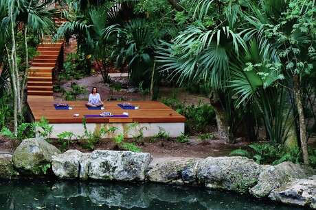 Yoga takes place on a platform overlooking a cenote at Chable Resort & Spa near Merida, Mexico.