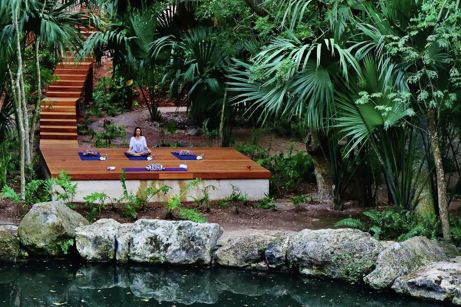 Yoga takes place on a platform overlooking a cenote at Chable Resort & Spa near Merida, Mexico. Photo: Alfredo Azar Photography