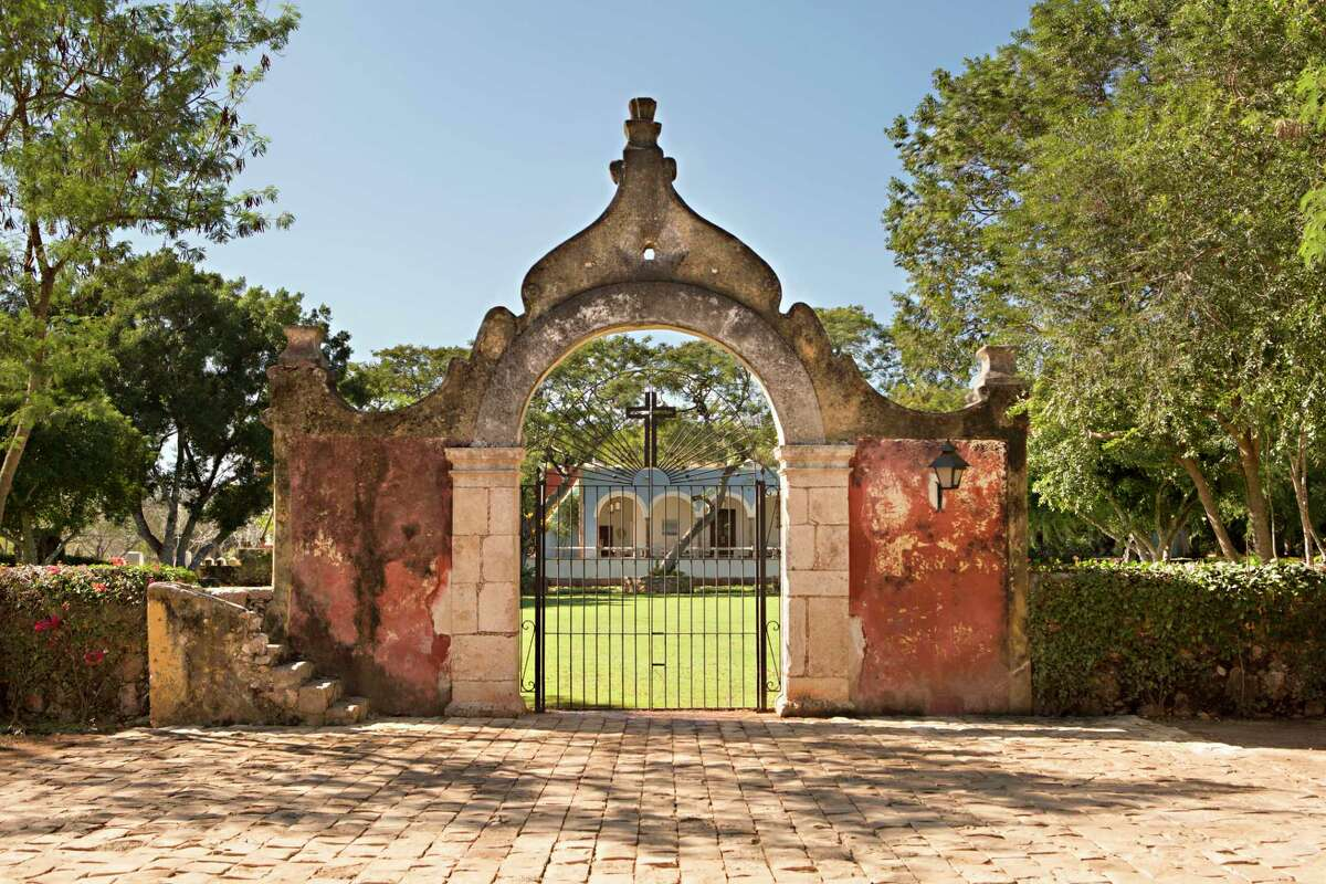 Stone arches mark the entrance to the hacienda at Chable Resort & Spa in Mexico.
